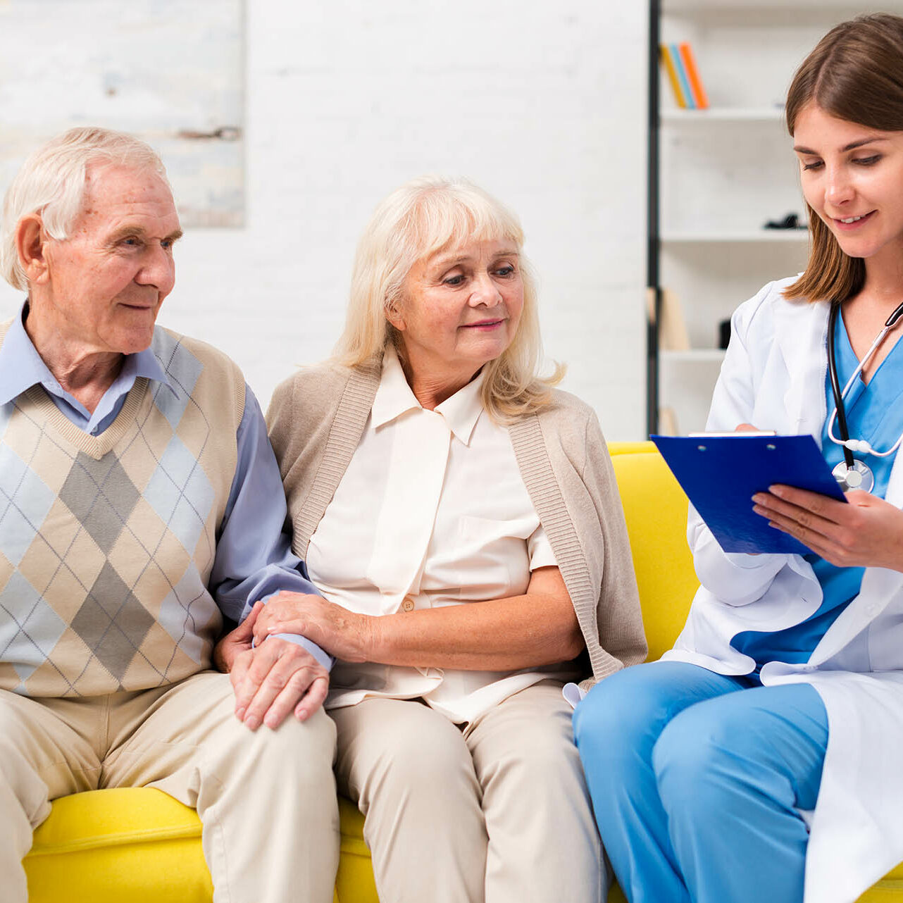 nurse-sitting-with-old-man-woman-sofa